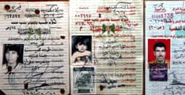 The Iraqi identity cards of Abeer Qassim Hamza al-Janabi, her mother, Fakhriya Taha al-Janabi (l) and her father Qasim Hamza al-Janabi
