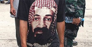A man wears a T-shirt with a picture of Osama Bin Laden