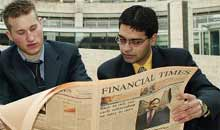 City workers reading the new look Financial Times
