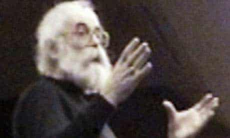 Undated image of Radovan Karadzic held up at a press conference in Belgrade