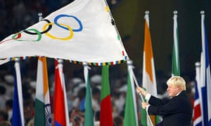 London's Mayor Boris Johnson waves the Olympic flag during the closing ceremony in the National Stadium at the Beijing 2008 Olympic Games August 24, 2008
