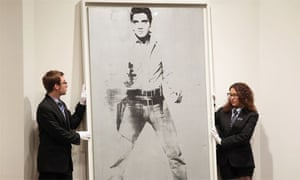 Andy Warhol's Double Elvis is auctioned at Sotheby's in New York.