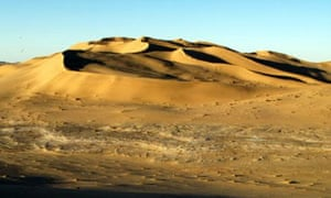 Sand dunes stretch into the distance on the northern edge of the Sahara desert at al-Ramla in western Libya Feb. 2, 2004. Since the government of Moammar Gadhafi began its campaign to open its doors to the outside world, tourists are increasingly visiting Libya.