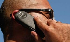 Scruffy man speaking on a Nokia mobile phone.