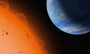 An artist's concept of the Neptune-sized planet GJ436b (right) orbiting an M dwarf star, Gliese 436, at a distance of only 3 million miles. With a density similar to that of Neptune, the exoplanet is an ice giant and probably has a rocky core and lots of water that forms ice in the interior under high pressure and temperature.