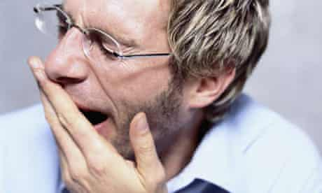 Man with Glasses Yawning