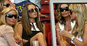Coleen McLoughlin (top L-partially hidden), the girlfriend of English forward Wayne Rooney, and Elen Rives (C), the girlfriend of English midfielder Frank Lampard and Alex Curran (R), fiancee of English midfielder Steven Gerrard, sit together with other friends and family members of the English team ahead of the round of 16 World Cup football match between England and Ecuador at Stuttgart's Gottlieb-Daimler Stadium, 25 June 2006