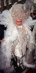 Flambouyant pop star Elton John leaving his London home in fancy dress on the way to his belated 50th birthday party. 11/4/01