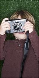 Boy taking a photograph