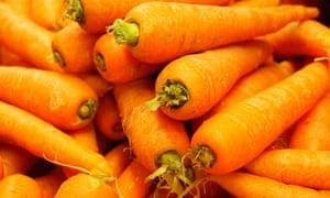 Pile of carrots, raw vegetables