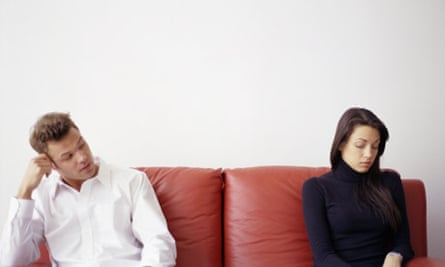 An unhappy couple on a couch