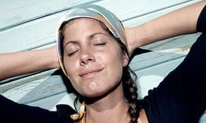 A woman relaxes with her eyes closed