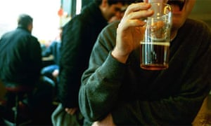 A man drinking a pint of beer