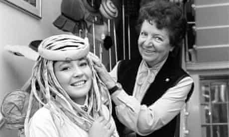 Royal milliner Simone Mirman with a model at her shop