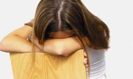 Sad or depressed Teenage Girl with her head down