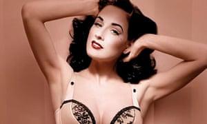 Dita von Teese wears peach satin lingerie from her Wonderbra range