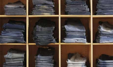 Piles of jeans in a store