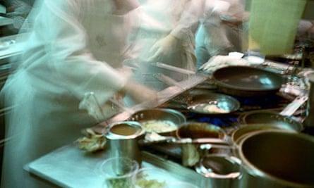 Chefs in a busy restaurant kitchen