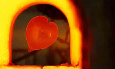 A heart shaped glass paperweight is made