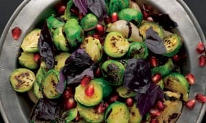 Pan-fried brussels sprouts and shallots with pomegranate and purple basil