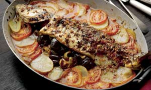 Chermoula-marinated sea bass stuffed with olives and preserved lemon