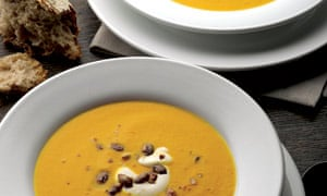 Pumpkin, saffron and orange soup with caramelised pumplin seeds