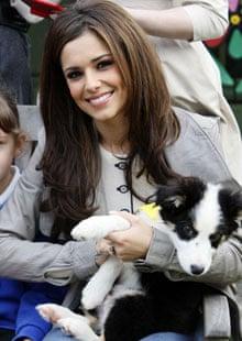 Cheryl Cole holding puppy