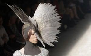 Gareth Pugh: A model wears a feathered headdress by Gareth Pugh