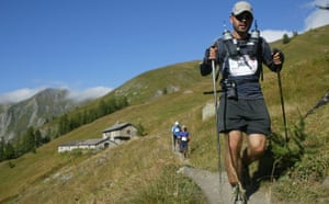 Race gallery: A runner makes the descent on the Ultra-Trail Mont Blanc