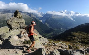 Race gallery: A runner at a summit on the Ultra-Trail Mont Blanc