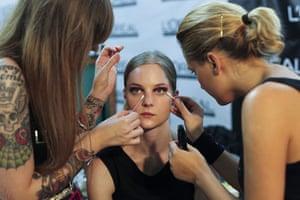 Lisbon fashion week: A model gets her makeup done backstage