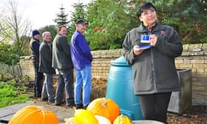"""Staff at Wimpole Hall using their new """"pee bale"""""""