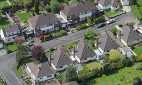 An aerial view of houses and gardens