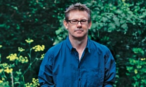 Nigel Slater holding a tray of vegetables