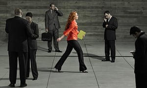 Young woman walking through business people