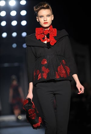 MFW: weekend roundup: Poppies adron this model's dress by Moschino