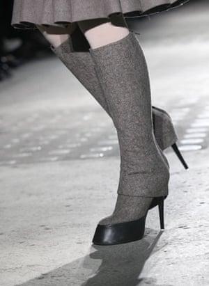 Paris FW Thursday: A model wears shoes by AF Vandevorst