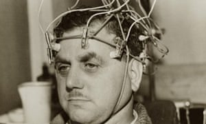 Man with electrodes attached to head