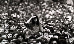 Woman peering over crowd