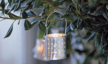Garden lantern hanging from a shrub