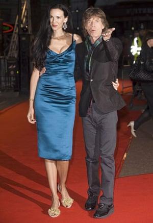 Men who wear stack heels: Mick Jagger and L'Wren Scott