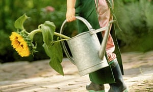 Girl carrying a watering can