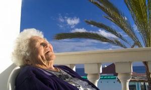 Elderly woman relaxing in the sun