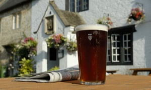 A pint of beer outside a pub