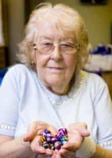 Jeane Smith holding her handmade jewellery