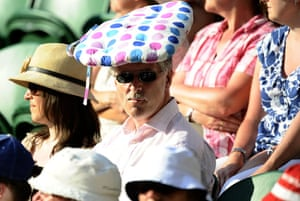 Wimbledon fashion: A spectator uses a cushion to shield himself from the sun
