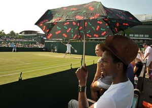 Wimbledon fashion: A man shelters from the sun with an umbrella