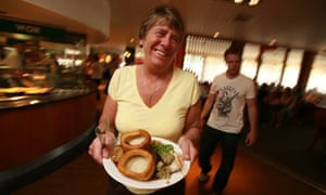 Customer with food from the buffet at Taybarns