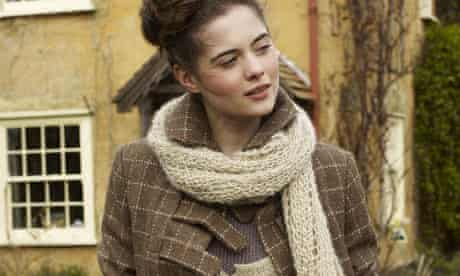 A model wears a jacket and scarf by Izzy Lane