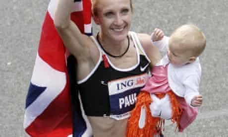 Paula Radcliffe holding her baby after winning the New York marathon